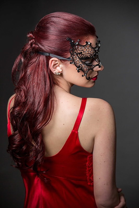Woman with Red Hair and Mask